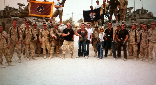 Tara Oram with her band and the troops in Afghanistan.
